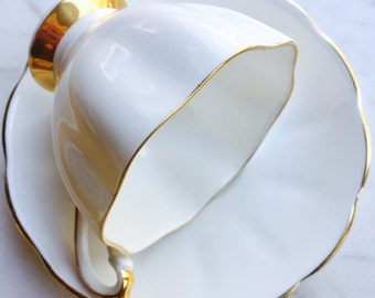 Queen Anne White and Gold Fluted Tea Cup and Saucer