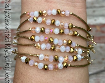 White and gold bracelets with gold plated charms - Semanario color blanco y oro con dijes de chapa de oro