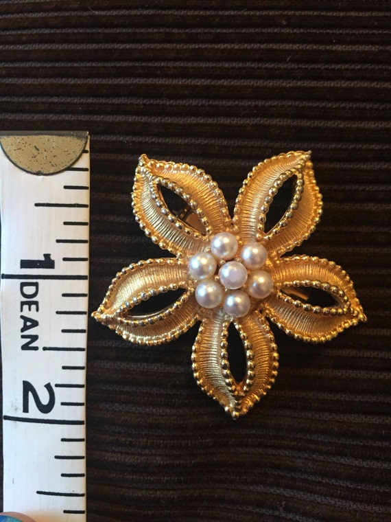 Gold metal flower brooch with pearls