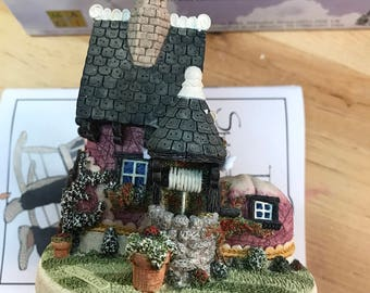 The shoemakers dream shoe house statue collectibles