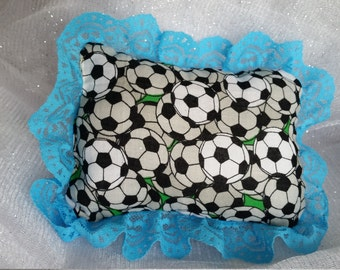 Small soccer themed doll pillow