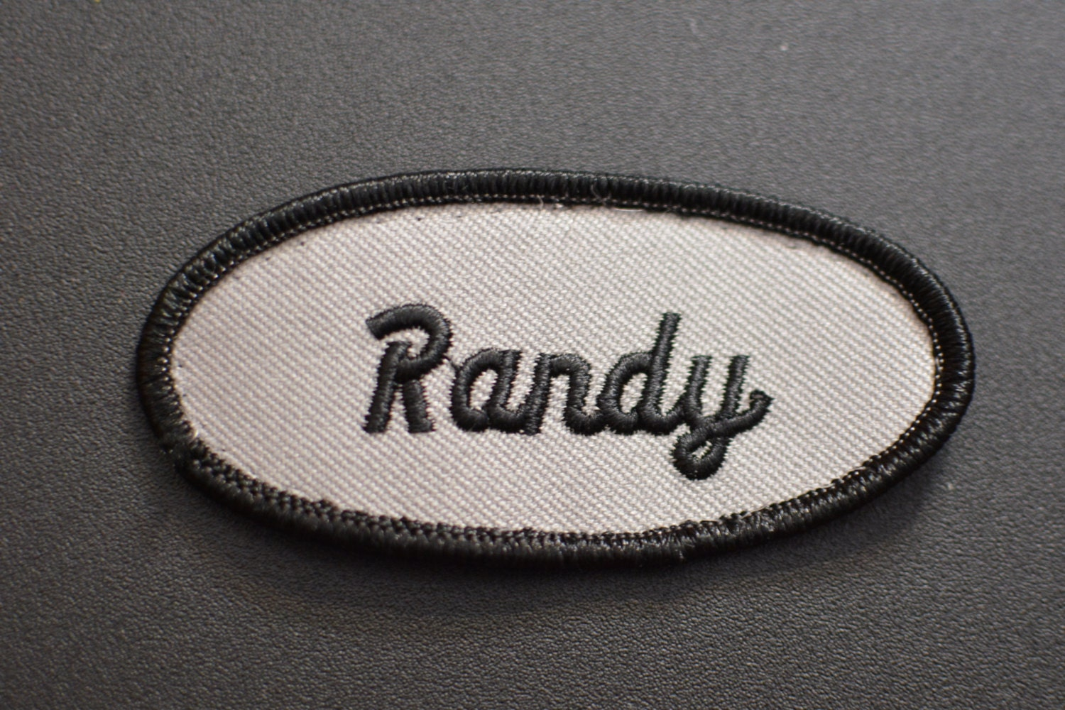 Black iron on name patch on gray background vintage for Mechanic shirts custom name patch