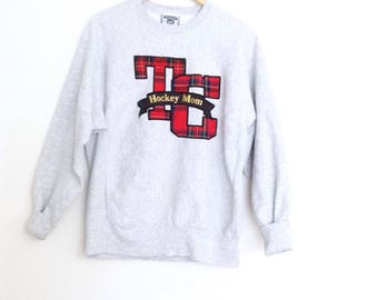 Vintage heather grey graphic print thick warm, oversized cotton sweatshirt. 90's TC hockey mom sweatshirt. Made in USA. Size large.