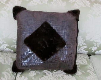 Leather and mink fur pillow.