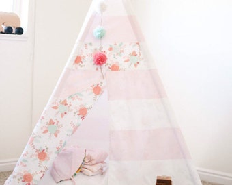 Pink and white teepee with floral accents