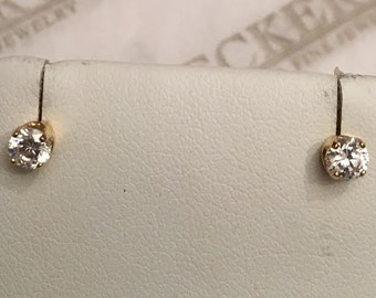 Vintage pair of 14k yellow gold Round CZ stud earrings, 4 prongs, each app. 4mm or app. .50 tw in size