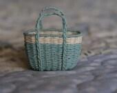 A miniature ivory and mint basket