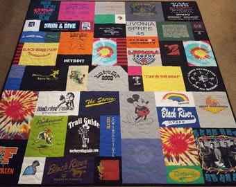 T shirt quilt custom made. Mosaic tshirt quilt. T-shirt quilt made from 10-55 tee shirts, with free embroidered label. Deposit only