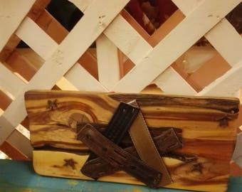 Handmade Leather Stars on either pine or cedar, 11x2x5