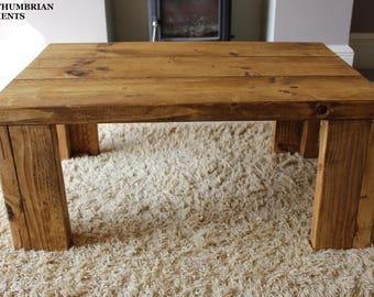 Rustic handcrafted reclaimed wooden coffee table in oak wax