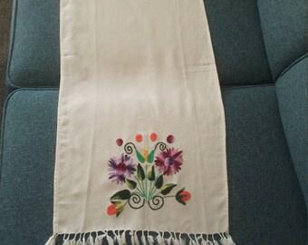 Vintage hand embroidered runner with floral design  looks folk art