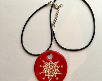 Handmade red circle necklace decorated with detail design