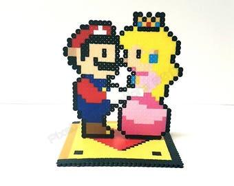 Super Mario Bros Mario & Princess Peach Wedding Cake Topper. Super Mario Bros Wedding Cake Topper. Super Mario Bros Anniversary Cake Topper