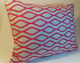 High quality embroidered cushion in a beautiful Clarke and Clarke geometric design with a contrasting cerise silk backing