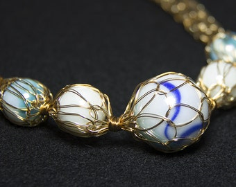 Knitted  gold necklace with marbles
