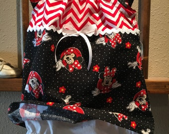 Baby girls Minnie Mouse top with white diaper cover.