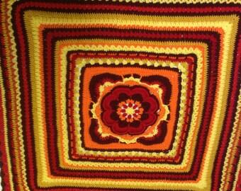 Crochet blanket in acrylic.