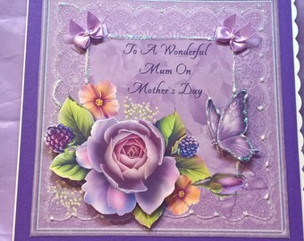 mother's day card with flowers,butterflies and glitter,a name can be added if requested when you order the card