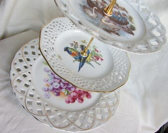 3 tier cake stand  of antique German porcelain plates with pierced borders. tea party stand, wedding cake. cup cakes.