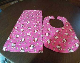 Hello kitty bib and burp cloth set.