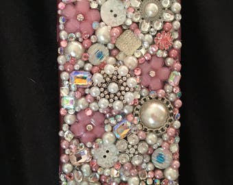 Pink and pearl IPhone 6+ phone case.