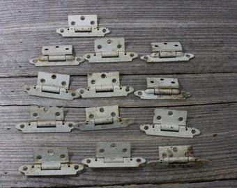 Set of 13 vintage metal cabinet hinges...circa 1950s