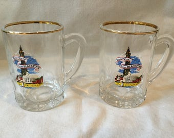 Two tourist souvenir from Blackpool shot glasses