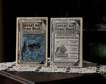 Two of Harry Oliver's Desert Rat Scrap Books, three of seven and two of nine.