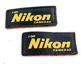 Two Leather Nikon Logo Patches