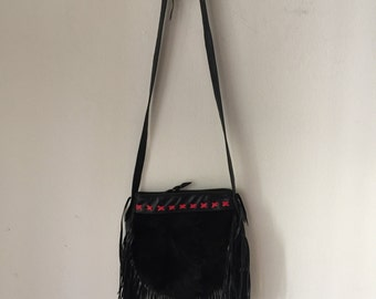 Stylish mink fur bag, women's size small.