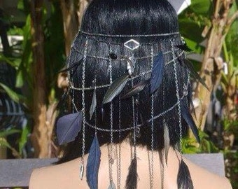 Anubis feathered head chain. Layered head chain with feathers, rhinestones, tear drop beads and inviciblw clips for your hair.