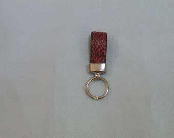 Handmade Keychain Python classic. Colors: red, yellow, and rock.