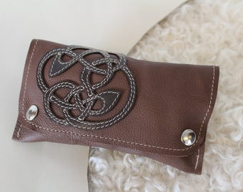 Brown tobacco pouch with celtic enterlace