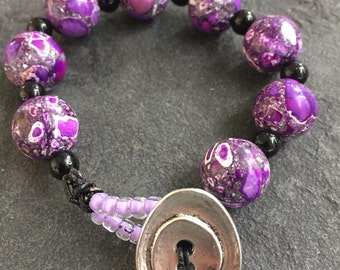 Beaded purple themed composite stone bracelet on leather cord with lilac seed beads and an antique silver clasp