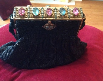 vintage Sydna Wynn black steel beaded purse with gorgeous frame made of brass with large colored rhinestones flowers