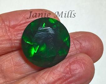 Emerald faceted gemstone 18mm round