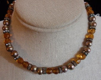 Vintage rhinestone, fauceted amber and and brass colored bead necklace