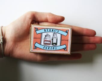 Illustrated 'curiosity' matchbox