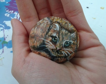 Rock painting red tabby cat