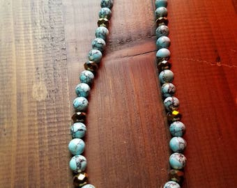 "Turquoise beaded necklace with swirled designs and gold beads, 19 1/2"", lobster claw clasp"