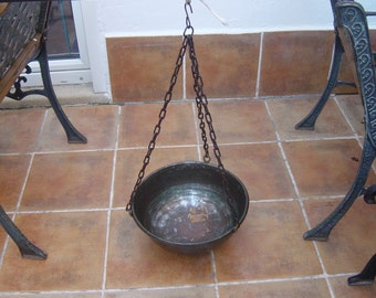 large hanging copper cooking pot