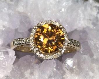 Orange zircon and diamond halo ring