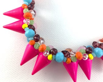 Neon crystal statement necklace in pink, turquoise and orange on bronze chain