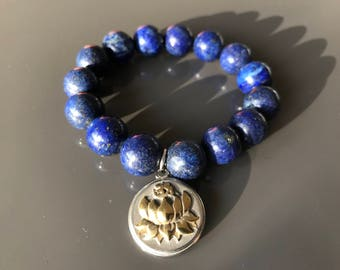 Sky stone lapis lazuli Stretch Bracelet with a Lotus Medallion made of stainless steel. Healing the throat chakra and third eye.