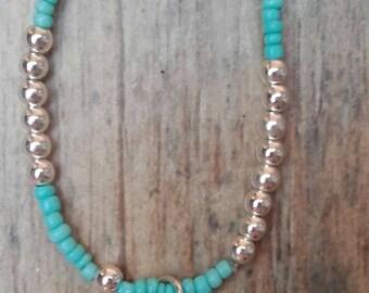 Bracelet granite... The blue of the graduation of her pendant