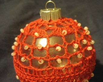Red crochet over clear bulb with pearl bead accents