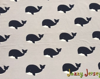 Whales on grey cotton jersey fabric