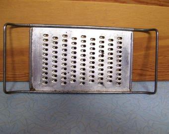Vintage metal grater