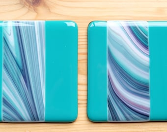 Pair of turquoise swirl fused glass coasters