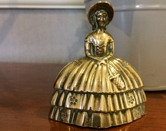 Crinoline, bonetted, brass lady bell with clanger